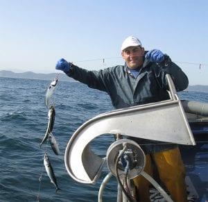 Mand der fanger fisk - ØkoTaste - Økologiske specialiteter
