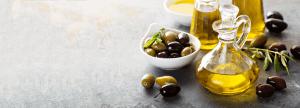 Olivenolie på marmorbord - Økotaste - Økologiske specialiteter